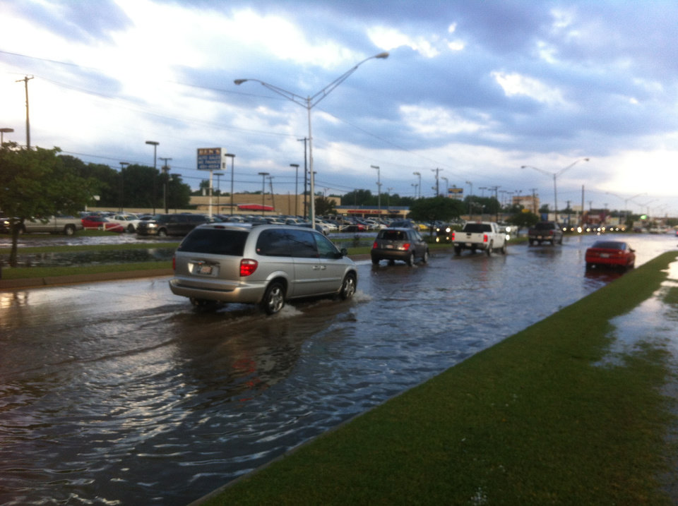 Photo - High water near NW 39th Expressway and N MacArthur. Photo by Robert Medley