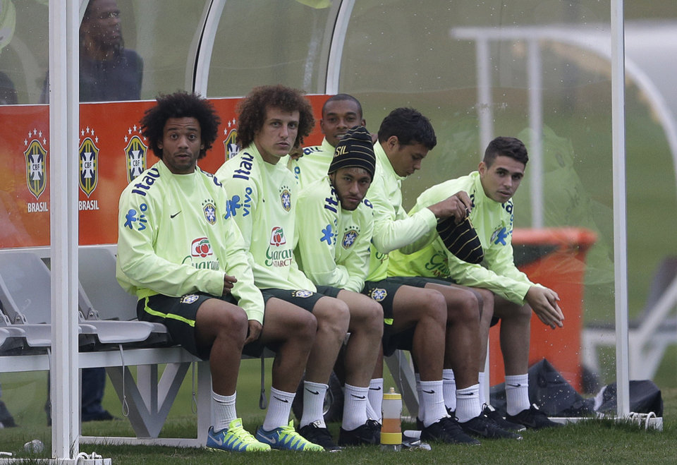 Photo - Brazilian players, from left, Marcelo, David Luiz, Neymar, Fernandinho, Thiago Silva, and Oscar, sit on the bench during a training session at the Granja Comary training center in Teresopolis, Brazil, Tuesday, July 1, 2014. Brazil will face Colombia on July 4 in the quarter-final of the 2014 soccer World Cup. (AP Photo/Andre Penner)
