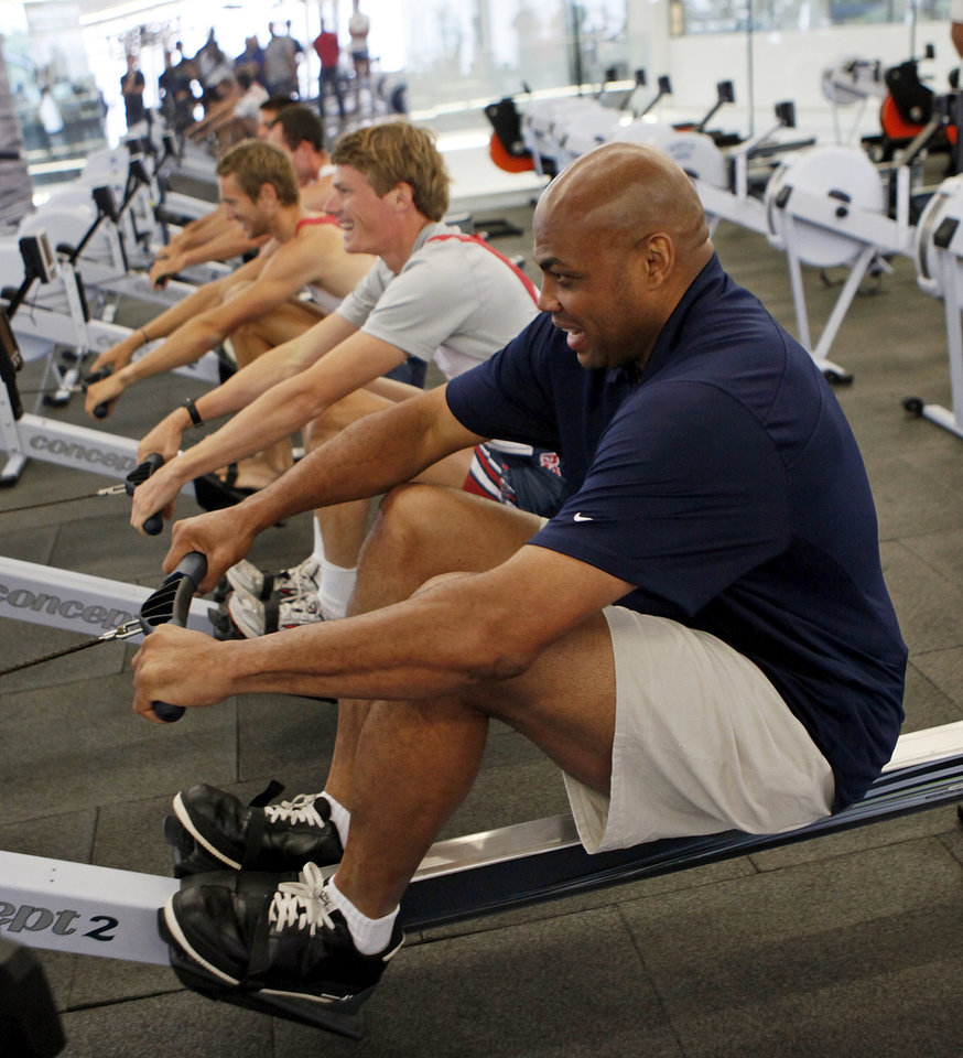 Photo - Charles Barkley tries an indoor rowing machine at the Devon Boathouse in Oklahoma City, Friday, June 1, 2012. Barkley visited the boathouse as part of a tour of Oklahoma City. Photo by Nate Billings, The Oklahoman