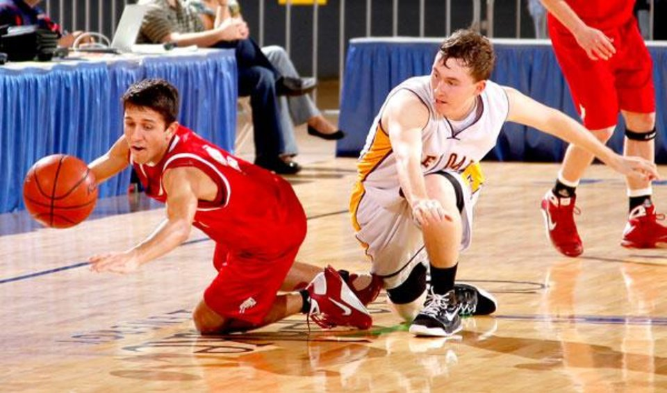 Photo -  Big Pasture's Dillon McGill, left, and Red Oak's Jordan Booth dive for the ball during the Class B boys basketball state tournament semifinal game between Red Oak and Big Pasture at the State Fair Arena in Oklahoma City, Friday, March 6, 2009. PHOTO BY BRYAN TERRY, THE OKLAHOMAN