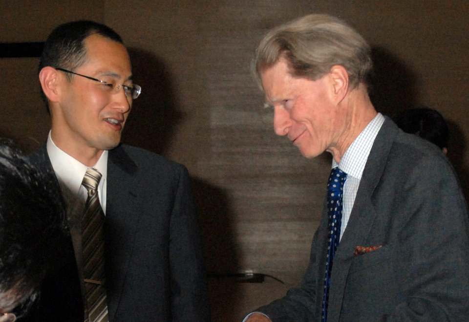Photo -   In this April, 2008 photo, Kyoto University Professor Shinya Yamanaka, left, and British researcher John Gurdon exchange words as they attend a symposium on induced pluripotent stem cell in Tokyo. Gurdon and Yamanaka of Japan won this year's Nobel Prize in physiology or medicine on Monday, Oct. 8, 2012 for discovering that mature, specialized cells of the body can be reprogrammed into stem cells - a discovery that scientists hope to turn into new treatments. (AP Photo/Kyodo News) JAPAN OUT, MANDATORY CREDIT, NO LICENSING IN CHINA, FRANCE, HONG KONG, JAPAN AND SOUTH KOREA