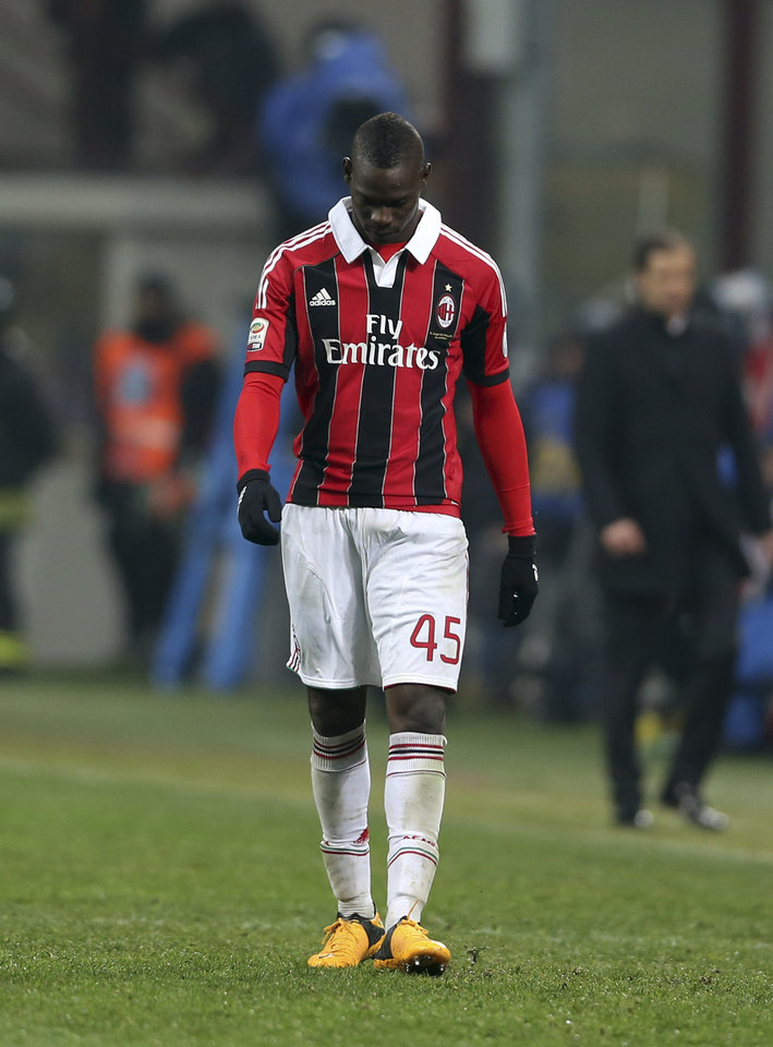 Photo - AC Milan forward Mario Balotelli walks off the pitch at the end of a Serie A soccer match between Inter Milan and AC Milan, at the San Siro stadium in Milan, Italy, Sunday, Feb. 24, 2013. The match ended in a 1-1 draw. (AP Photo/Luca Bruno)