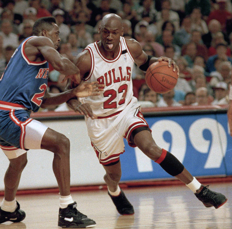 Photo - FILE - In this May 17, 1992 file photo, Chicago Bulls' Michael Jordan drives on New York Knicks' Gerald Wilkins during the first quarter of Game 7 of the Eastern Conference semifinals in Chicago. Jordan believes he could beat LeBron James in a one-on-one basketball game when he was in his prime. (AP Photo/John Swart, File)