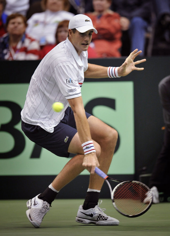 Photo - United States' John Isner returns a shot from Brazil's Thiago Alves during a first-round Davis Cup tennis match, Friday, Feb. 1, 2013, in Jacksonville, Fla. Isner won 6-3, 7-6 (4), 6-3. (AP Photo/Florida Times-Union, Will Dickey)