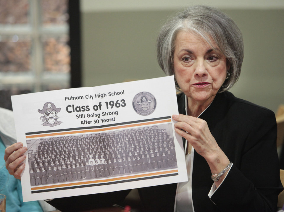 Photo - Edie Snell held a copy of the class photo from Putnam City High School class of 1963 while she talked about her high school experience and Project Talent, Thursday, October 31, 2013. Photo by David McDaniel, The Oklahoman  David McDaniel - The Oklahoman