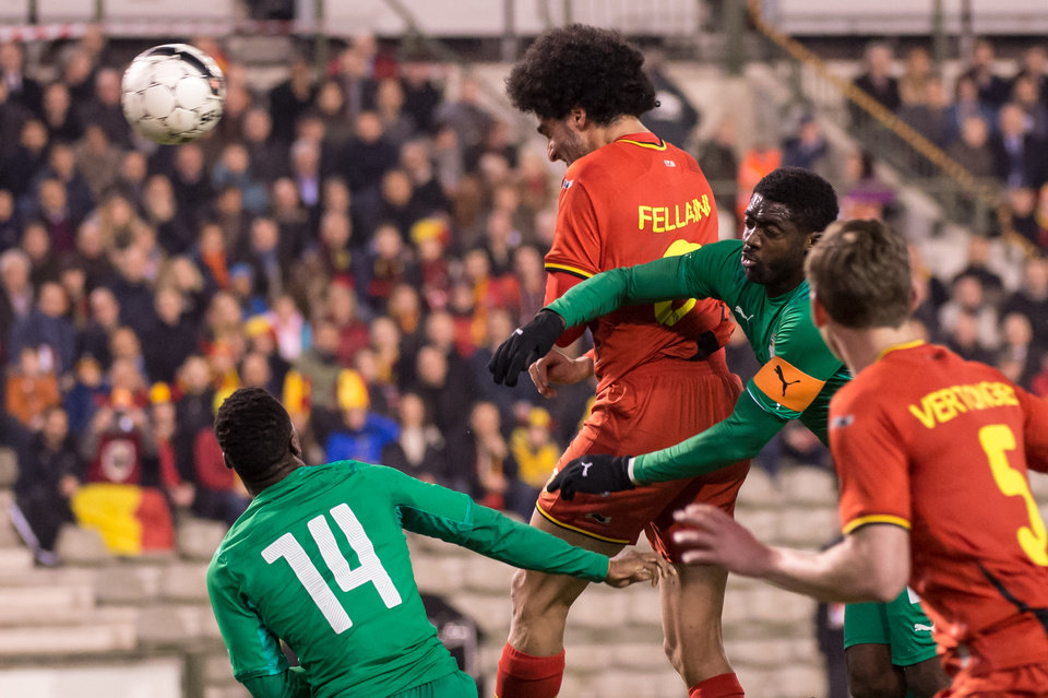 Photo - Belgium's Marouane Fellaini, center, challenges Ivory Coast's Kolo Toure and scores during a friendly soccer match at the King Baudouin stadium in Brussels on Wednesday March 5, 2014. (AP Photo/Geert Vanden Wijngaert)
