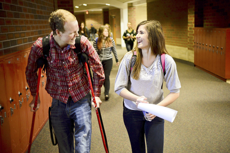 Zach Sobiech, left, walks with his girlfriend, Amy Adamle, between classes at Stillwater High School in Stillwater, Minn., on Dec. 3, 2012.