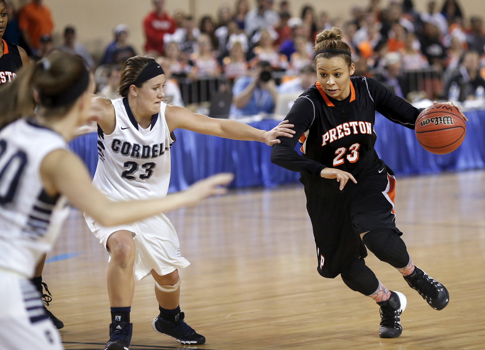 Photo - Preston starter Chelsea Dungee turns on the speed as she finds an opening in the Cordell defense during the Class 2A Girls State Championship game between Preston and Cordell at Jim Norick Arena at State Fair Park  on Saturday, Mar. 15, 2014. Codell #23 is Morgen Price.  Preston won,  45-41. Photo by Jim Beckel, The Oklahoman