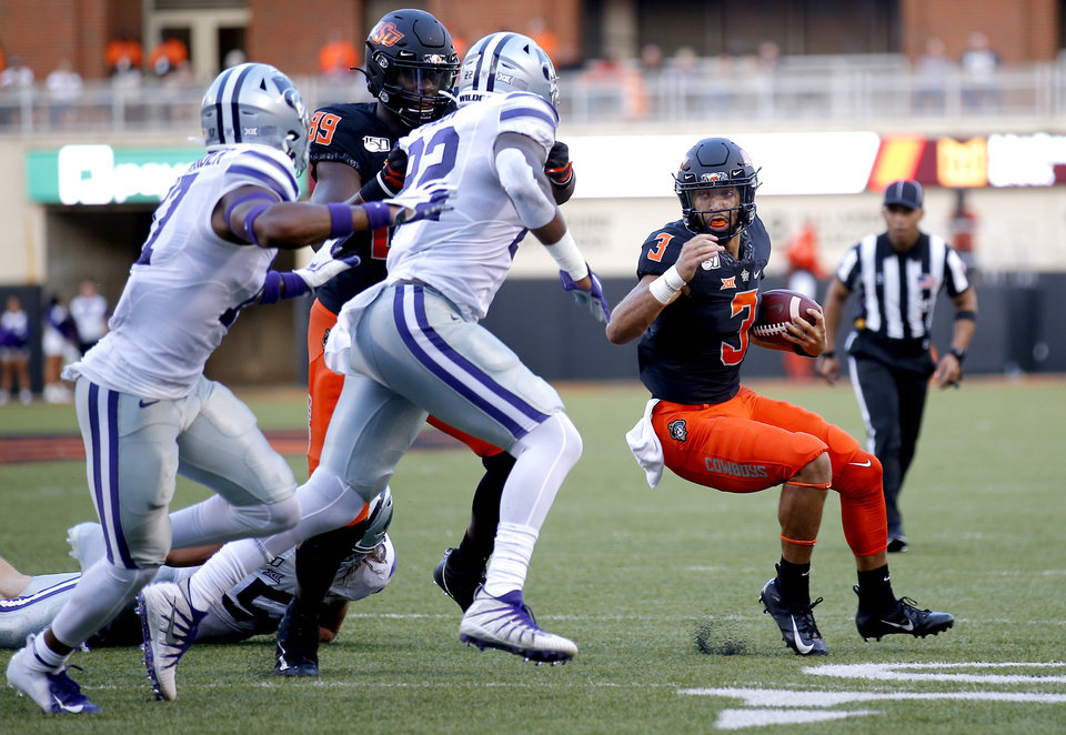 Photo - Oklahoma State's Spencer Sanders (3) rushes in the second quarter during the college football game between the Oklahoma State Cowboys and the Kansas State Wildcats at Boone Pickens Stadium in Stillwater, Okla., Saturday, Sept. 28, 2019. [Sarah Phipps/The Oklahoman]