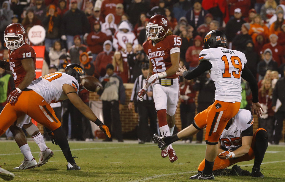 Photo - Oklahoma State's Ben Grogan (19) kicks the game-winning field goal during a Bedlam college football game between the University of Oklahoma Sooners (OU) and the Oklahoma State Cowboys (OSU) at Gaylord Family-Oklahoma Memorial Stadium in Norman, Okla., Saturday, Dec. 6, 2014. Photo by Bryan Terry, The Oklahoman