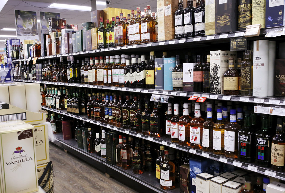 Photo -  Liquor stores, such as Byron's Liquor Warehouse, shown here, won't be the only outlet for liquor and higher-point beer if a ballot measure passes in November. [Photo by Jim Beckel, The Oklahoman]