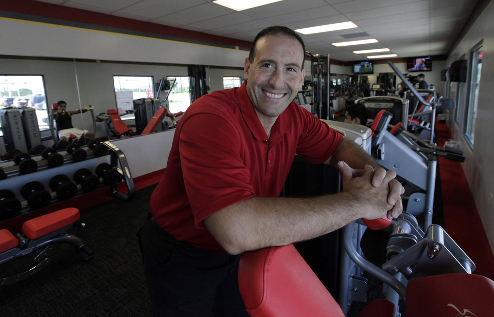 Photo -   ADDS FULL NAME OF GYM - In this June 14, 2012, photo, manager Rick Limitone poses for a photo at Snap Fitness Rolling Strong Gym, a truck stop gym in Dallas. From trucking companies embracing wellness and weight-loss programs to gyms being installed at truck stops, momentum has picked up in recent years to help those who make their living driving big rigs get into shape. (AP Photo/LM Otero)
