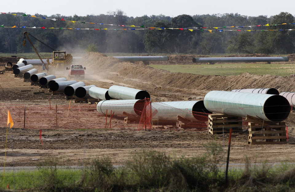 Photo -  Large sections of pipe are shown on a neighboring property to Julia Trigg Crawford family farm, in Sumner Texas. AP Archives Photo   Tony Gutierrez -  AP