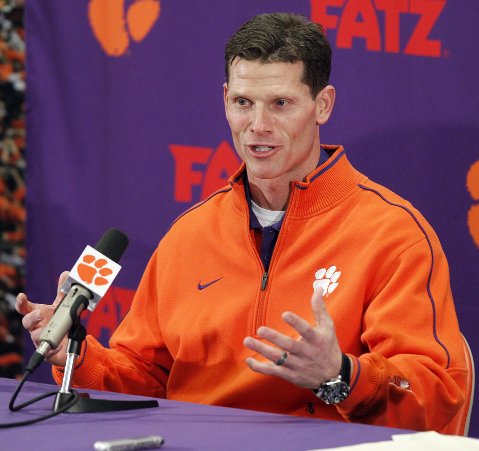 Photo - Brent Venables answers a question during an NCAA college football news conference where je was introduced as the new defensive coordinator at Clemson, on Friday, Jan. 20, 2012, in Clemson, S.C, (AP Photo/The Independent-Mail, Sefton Ipock) THE GREENVILLE NEWS OUT, SENECA NEWS OUT ORG XMIT: SCAND202