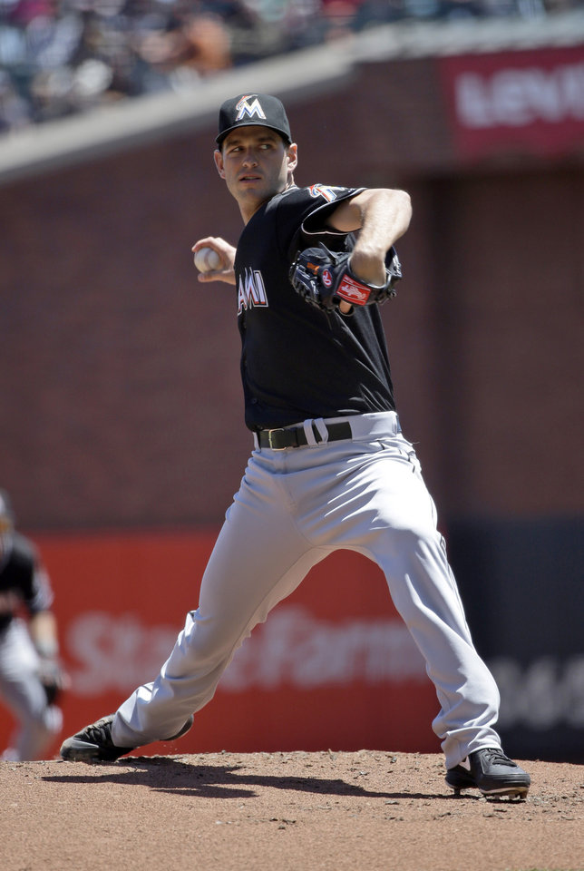 Photo - Miami Marlins starting pitcher Jacob Turner throws to the San Francisco Giants during the first inning of a baseball game on Sunday, May 18, 2014, in San Francisco. (AP Photo/Marcio Jose Sanchez)