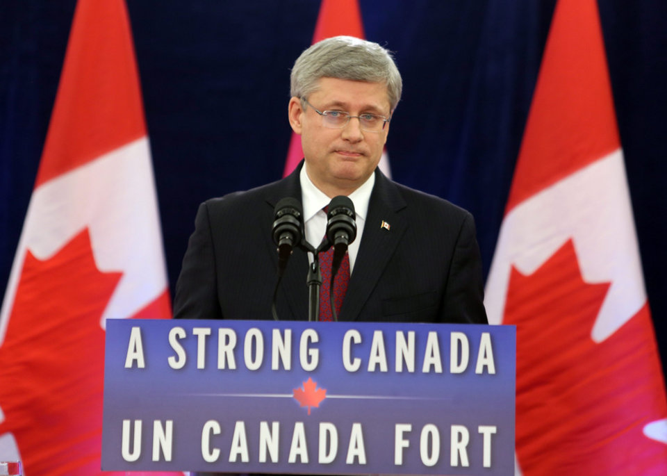 Photo - Canadian Prime Minister Stephen Harper delivers a statement regarding the federal government review of the $15.1-billion takeover of Nexen Inc. by China's CNOOC Ltd. and the $6-billion takeover of Progress by Malaysia's Petronas, Friday Dec. 7, 2012. (AP Photo/The Canadian Press, Fred Chartrand)
