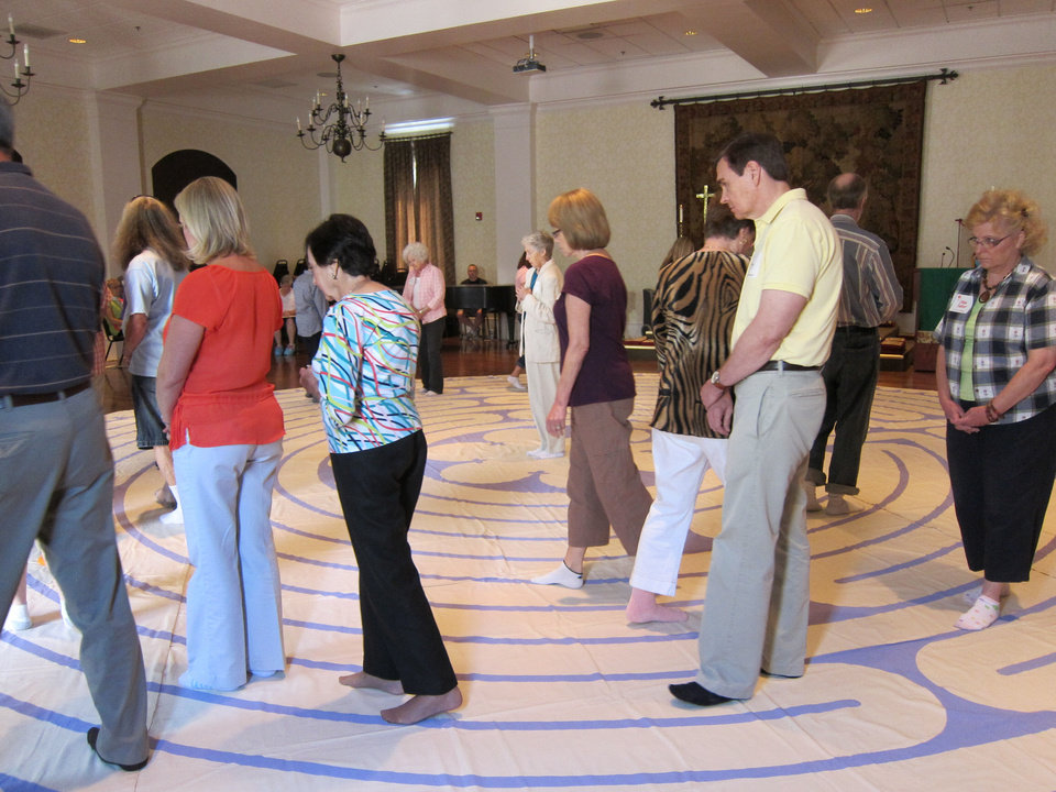 Photo - Several people walk an 11-circuit labyrinth during