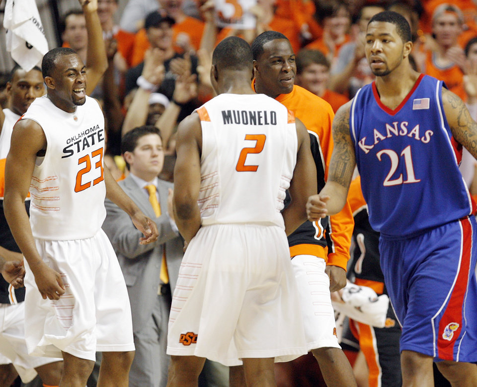 Photo - From left, OSU's James Anderson (23), Obi Muonelo (2) and Torin Walker (10) celebrate in front of KU's Markieff Morris (21) in the first half during the men's college basketball game between the University of Kansas (KU) and Oklahoma State University (OSU) at Gallagher-Iba Arena in Stillwater, Okla., Saturday, Feb. 27, 2010. Photo by Nate Billings, The Oklahoman