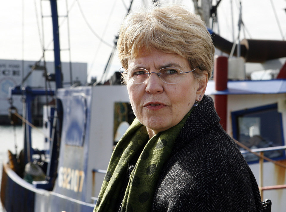 Photo - FILE - In this March 2, 2010 file photo, National Oceanic and Atmospheric Administration, NOAA, chief, Jane Lubchenco looks out from the waterfront as she speaks to fisherman in Gloucester, Mass. The head of the National Oceanic and Atmospheric Administration said Wednesday, Dec. 12, 2012 she will leave her post at the end of February 2013. (AP Photo/Mary Schwalm, File)