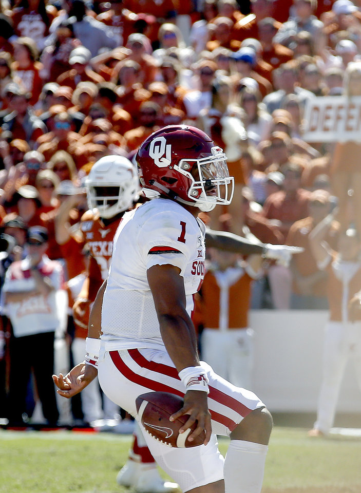 Photo - Oklahoma's Jalen Hurts (1) celebrates a touchdown in the fourth quarter during the Red River Showdown college football game between the University of Oklahoma Sooners (OU) and the Texas Longhorns (UT) at Cotton Bowl Stadium in Dallas, Saturday, Oct. 12, 2019. OU won 34-27. [Sarah Phipps/The Oklahoman]