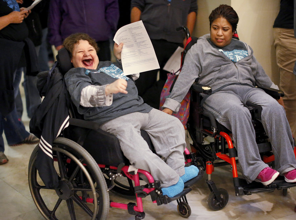 Photo -  More than 700 people crowded the state Capitol on Thursday to rally for the developmentally disabled. Patricia Hudson, left, and Luz Moreno came with a group from the Dale Rogers Training Center in Oklahoma City. Photo by Jim Beckel, The Oklahoman   Jim Beckel -