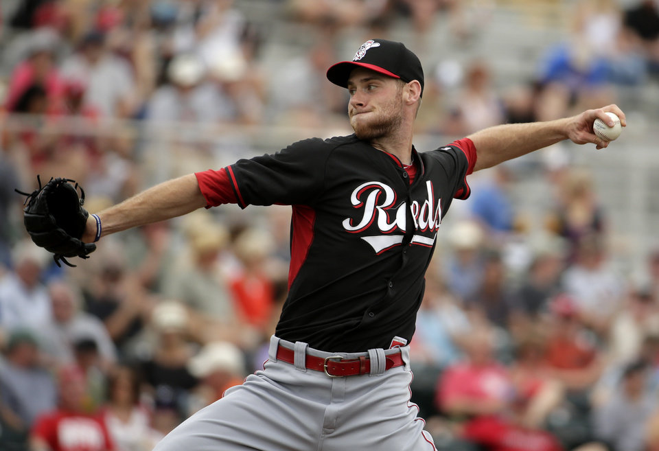 Photo - Cincinnati Reds starting pitcher Tony Cingrani throws to the San Francisco Giants during the firth inning of a spring training baseball game in Scottsdale, Ariz., Thursday, March 6, 2014. (AP Photo/Chris Carlson)