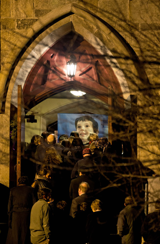 An image of 6-year-old Sandy Hook Elementary School shooting victim Benjamin Andrew Wheeler is displayed at the entrance to Trinity Episcopal Church as mourners file in for his wake, Wednesday, Dec. 19, 2012, in Newtown, Conn. (AP Photo/David Goldman)