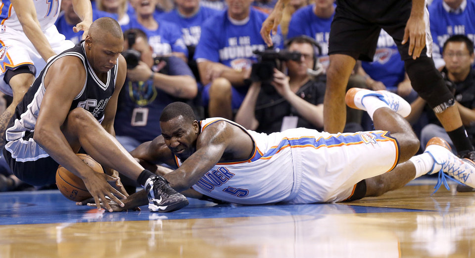 Photo - Oklahoma City's Kendrick Perkins (5) and  San Antonio's Boris Diaw (33) scramble for a loose ball during Game 4 of the Western Conference Finals in the NBA playoffs between the Oklahoma City Thunder and the San Antonio Spurs at Chesapeake Energy Arena in Oklahoma City, Tuesday, May 27, 2014. Photo by Nate Billings, The Oklahoman