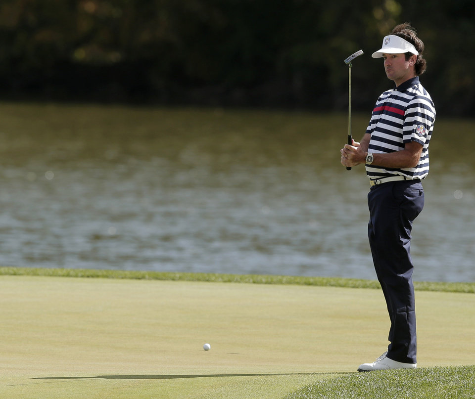 Photo - USA's Bubba Watson reacts after missing a putt on the second hole during a singles match at the Ryder Cup PGA golf tournament Sunday, Sept. 30, 2012, at the Medinah Country Club in Medinah, Ill. (AP Photo/Charlie Riedel)  ORG XMIT: PGA125