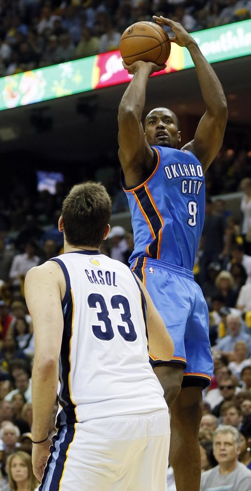 Oklahoma City's Serge Ibaka (9) shoots over Memphis' Marc Gasol (33) in the first half during Game 4 of the second-round NBA basketball playoff series between the Oklahoma City Thunder and the Memphis Grizzlies at FedExForum in Memphis, Tenn., Monday, May 13, 2013. Photo by Nate Billings, The Oklahoman