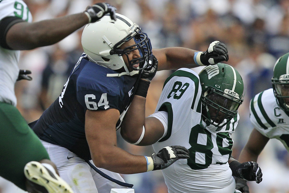 Photo - FILE - In this Sept. 1, 2012 file photo, Penn State guard John Urschel (64) battles with Ohio defensive lineman Carl Jones (89) during the first quarter of an NCAA college football game at Beaver Stadium in State College, Pa. The all-Big Ten, third-team AP All-American has a Master's degree in math and was awarded the William V. Campbell Trophy as college football's top scholar-athlete. (AP Photo/Gene J. Puskar, File)