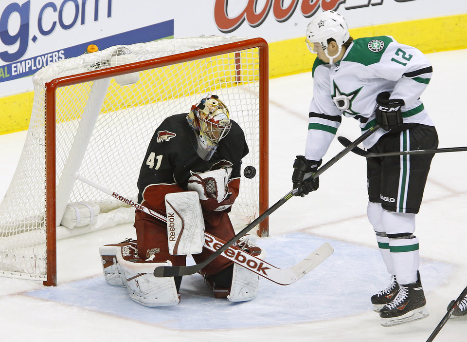Photo - Phoenix Coyotes goalie Mike Smith (41) makes a save against Dallas Stars right wing Alex Chiasson (12) during the first period of their NHL hockey game, Tuesday, Feb. 4, 2014 in Glendale. (AP Photo/The Arizona Republic, David Kadlubowski)