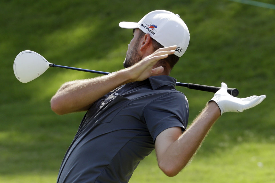 Photo - Troy Merritt lets go of his driver as he tees off on the first hole during the third round of the St. Jude Classic golf tournament Saturday, June 7, 2014, in Memphis, Tenn. (AP Photo/Mark Humphrey)