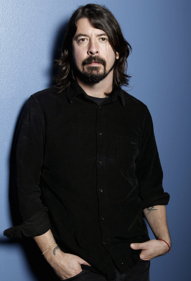 Photo -   FILE - In this Jan. 31, 2012 file photo, musician Dave Grohl poses for a portrait in Los Angeles. The often eloquent Foo Fighters frontman has signed on to give the keynote speech at the 2013 South By Southwest Music Conference on March 14 in Austin, Texas. He's also working on his Sound City documentary and new Queens Of The Stone Age material with Josh Homme. Both are expected to be early released early next year. (AP Photo/Matt Sayles, file)