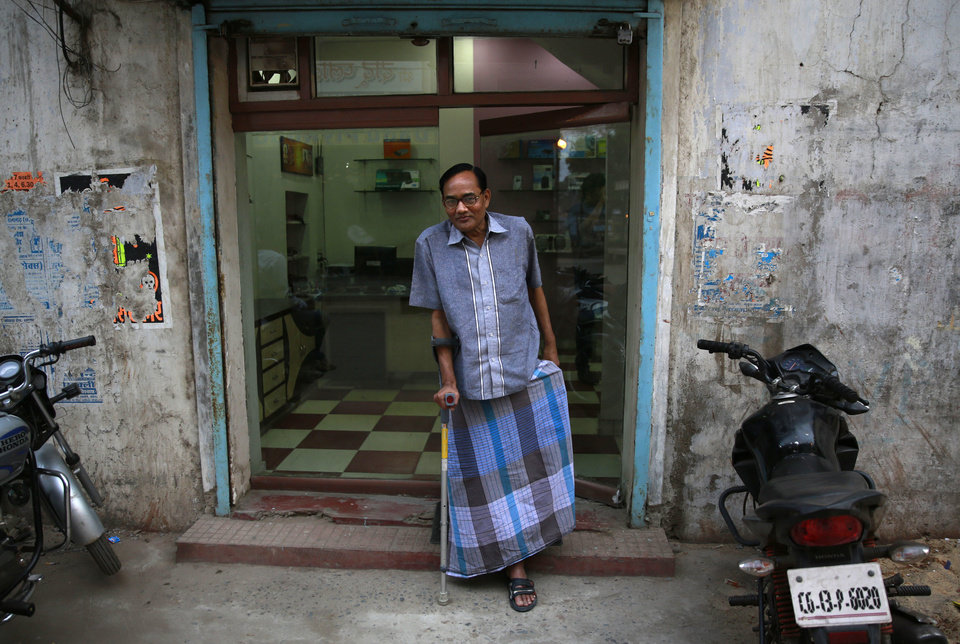 Photo - In this April 15, 2014 photo, India's Ramesh Agrawal walks outside his shop during an interview in Raigarh in Chhattisgarh state, India. Six environmental advocates from India, Peru, Russia and three other nations have won this year's Goldman Prize, which is awarded annually for grass-roots activism. Agrawal received the prize for helping villagers fight a large coal mine in Chhattisgarh state, the San Francisco-based Goldman Environmental Foundation said Monday. (AP Photo/Rafiq Maqbool)