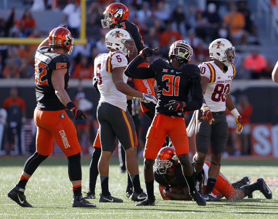 Photo - Oklahoma State's Tre Flowers (31) celebrates an OSU fumble recovery in the third quarter during a college football game between the Oklahoma State University Cowboys (OSU) and the Iowa State University at Boone Pickens Stadium in Stillwater, Okla., Saturday, Oct. 8, 2016. Photo by Sarah Phipps, The Oklahoman
