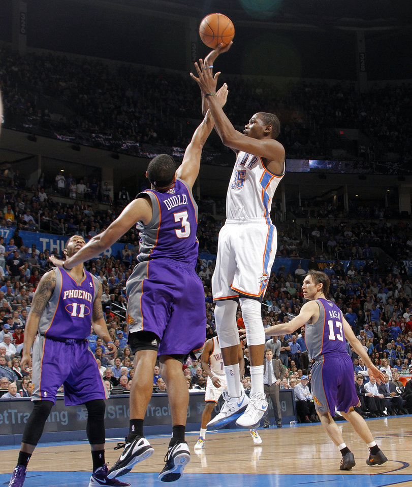 Photo - Oklahoma City Thunder small forward Kevin Durant (35) puts up a shot over Phoenix Suns small forward Jared Dudley (3) during the NBA basketball game between the Oklahoma City Thunder and the Phoenix Suns at the Chesapeake Energy Arena on Wednesday, March 7, 2012 in Oklahoma City, Okla.  Photo by Chris Landsberger, The Oklahoman