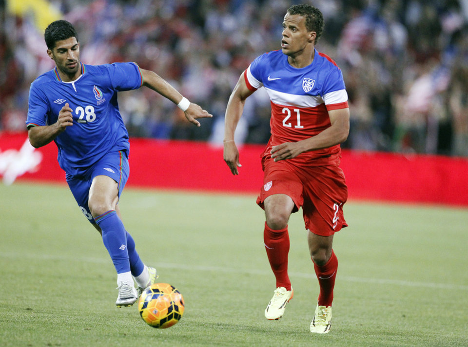 Photo - United States' Timmy Chandler, right, dribbles past Azerbaijan's Pardis Fardjad-Azad during the second half of an international friendly soccer match on Tuesday, May 27, 2014, in San Francisco.  United States won 2-0. (AP Photo/Thomas Mendoza)