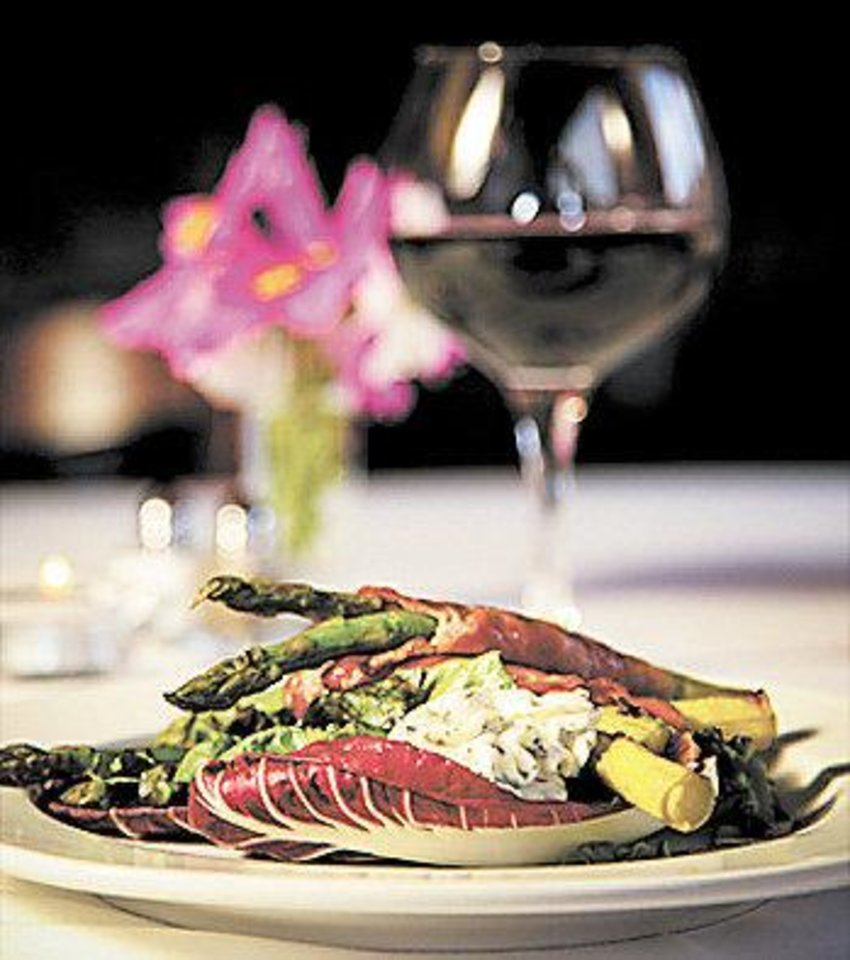 THE CANEBRAKE / ECO-FRIENDLY REJUVENATION SPA: Proscuitto-Wrapped Asparagus in fresh Radicchio is among dishes served at The Canebrake.