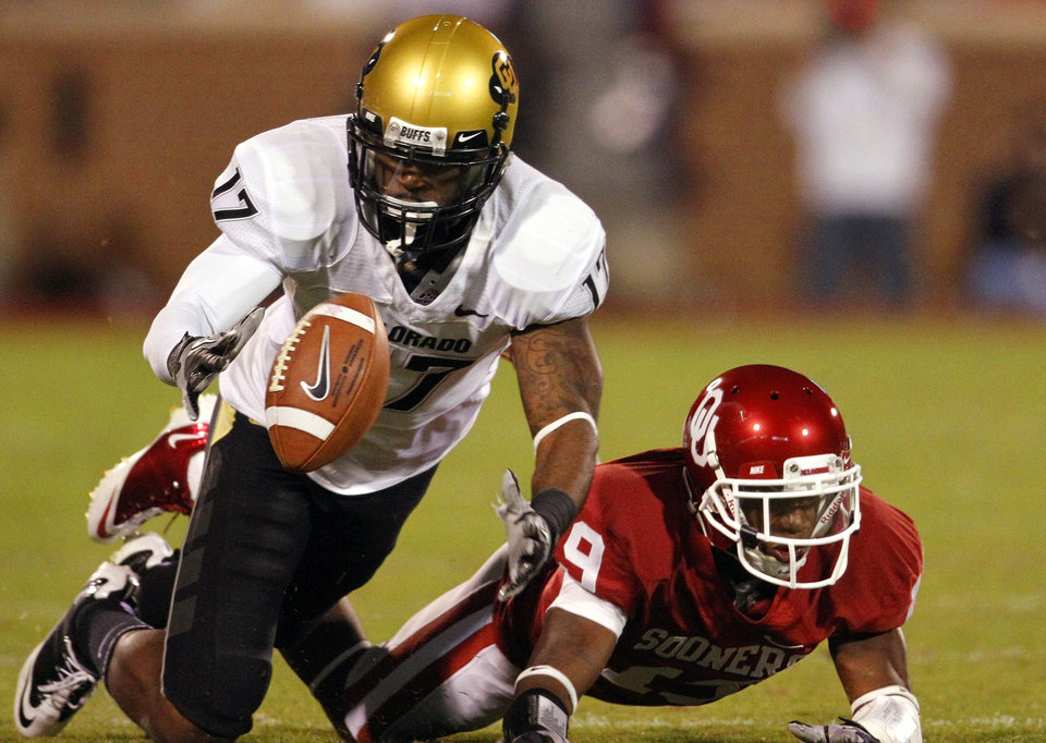 Photo - Demontre Hurst (19) breaks up a pass intended for Toney Clemons (17) during the first half of the college football game between the University of Oklahoma (OU) Sooners and the University of Colorado Buffaloes at Gaylord Family-Oklahoma Memorial Stadium in Norman, Okla., Saturday, October 30, 2010.  Photo by Steve Sisney, The Oklahoman