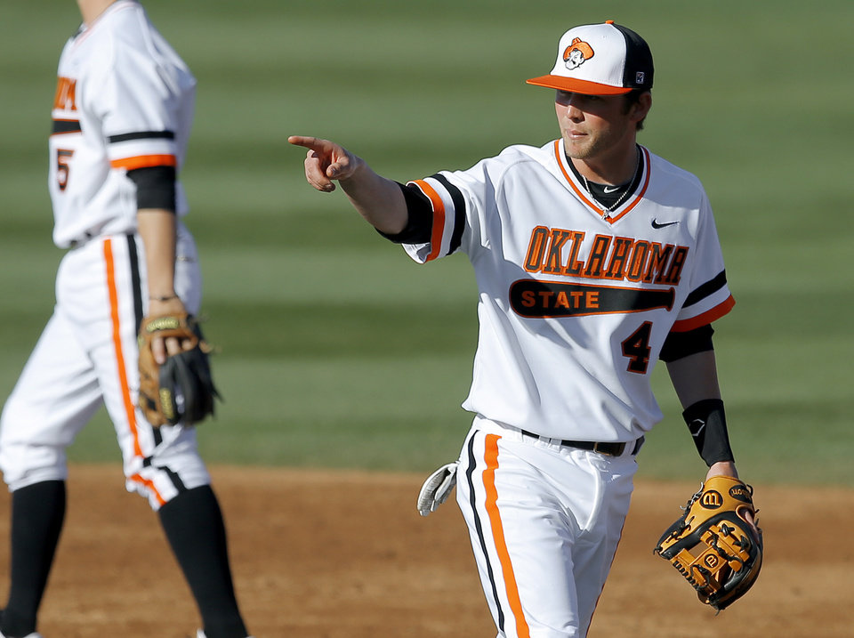 Oklahoma State's Brendan McCurry points back to the dugout after an out in the third inning of OSU's college baseball game against Alcorn State in Stillwater, Okla., Tuesday, Feb. 19, 2013. Photo by Bryan Terry, The Oklahoman