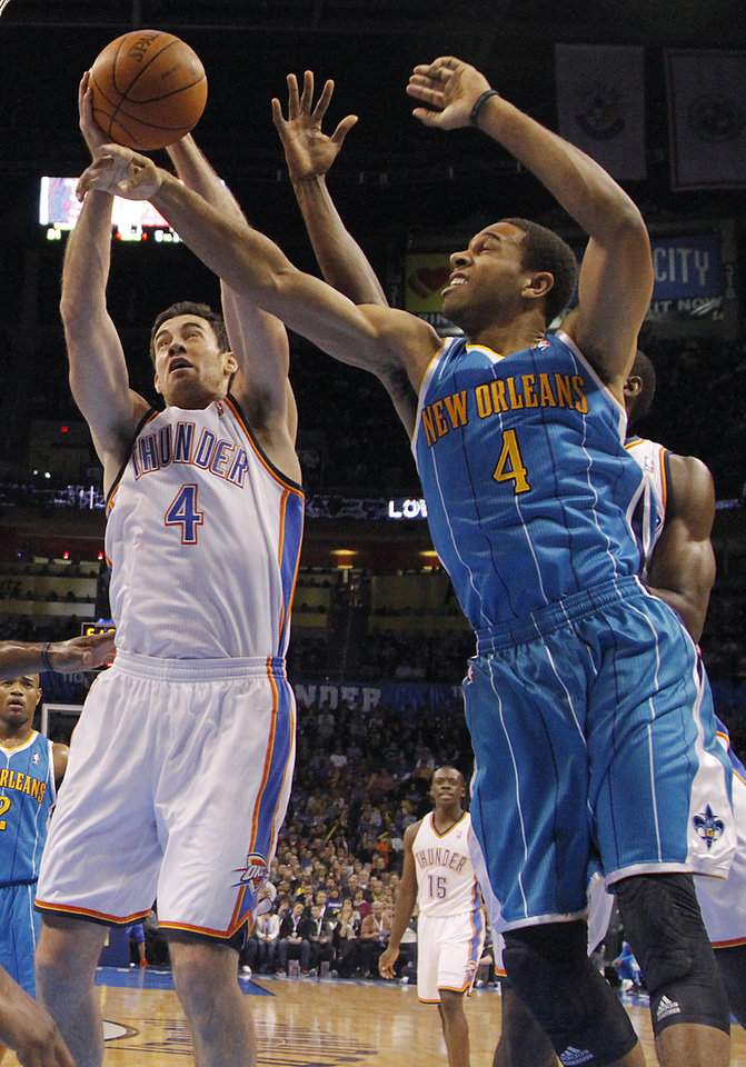 Oklahoma City Thunder power forward Nick Collison (4) and New Orleans Hornets shooting guard Xavier Henry (4) battle for a rebound during the NBA basketball game between the Oklahoma City Thunder and the New Orleans Hornets at the Chesapeake Energy Arena on Wednesday, Jan. 25, 2012, in Oklahoma City, Okla. Photo by Chris Landsberger, The Oklahoman