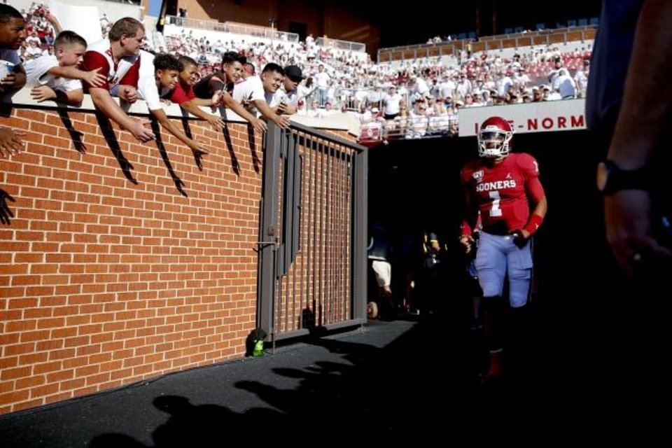 Photo -  Oklahoma's Jalen Hurts jogs to the field before leading the Sooners to a 49-31 victory against Houston in Sunday's season opener in Norman. [Bryan Terry/The Oklahoman]