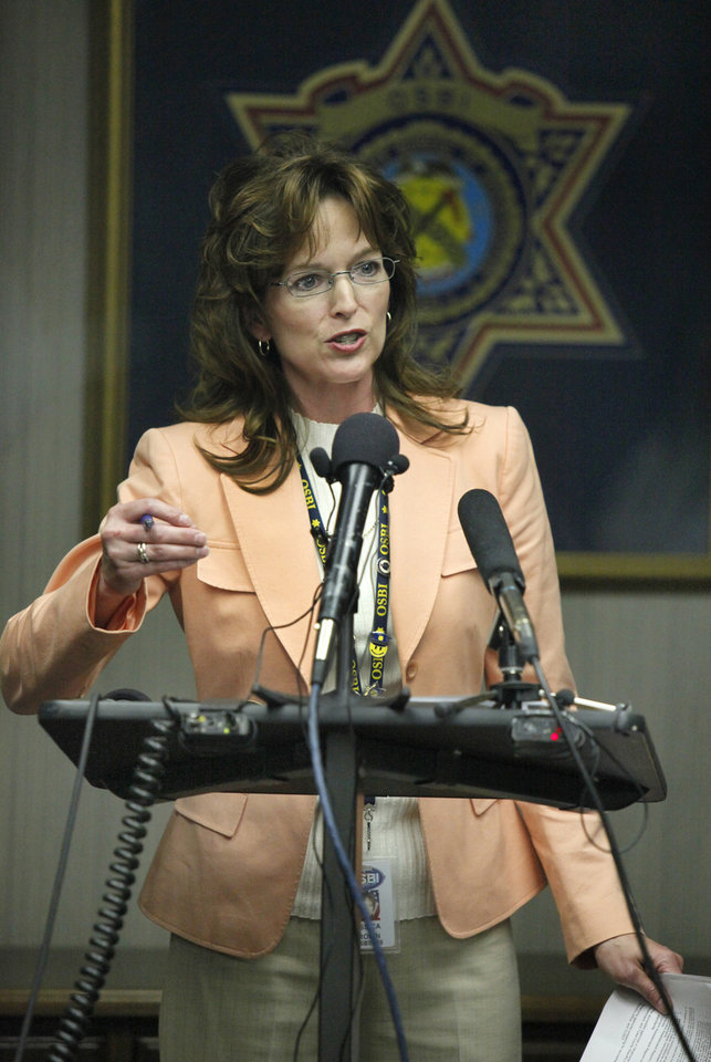 Photo - OSBI: Jessica Brown, spokeswoman for the Oklahoma State Bureau of Investigation, answers a question during a news conference in Oklahoma City, Oklahoma April 06 , 2010. Photo by Steve Gooch, The Oklahoman ORG XMIT: KOD