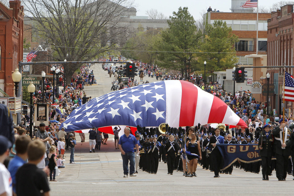 Boy Scouts carry a huge American flag in the 89ers Day Parade in Guthrie, OK, Saturday, April 20, 2013, By Paul Hellstern, The Oklahoman