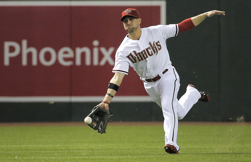 Photo - Arizona Diamondbacks' Ender Inciarte can't catch a base hit by Los Angeles Dodgers'  Dee Gordon during the fourth inning of a baseball game on Friday, May 16, 2014, in Phoenix. (AP Photo/Matt York)