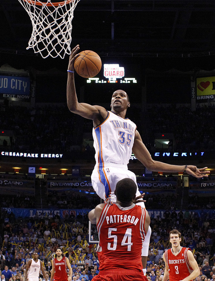 Photo - Oklahoma City's Kevin Durant (35) goes up for a shot as Houston's Patrick Patterson (54) defends during the NBA basketball game between the Oklahoma City Thunder and the Houston Rockets at the Chesapeake Energy Arena, Tuesday, March 13, 2012. Photo by Sarah Phipps, The Oklahoman.