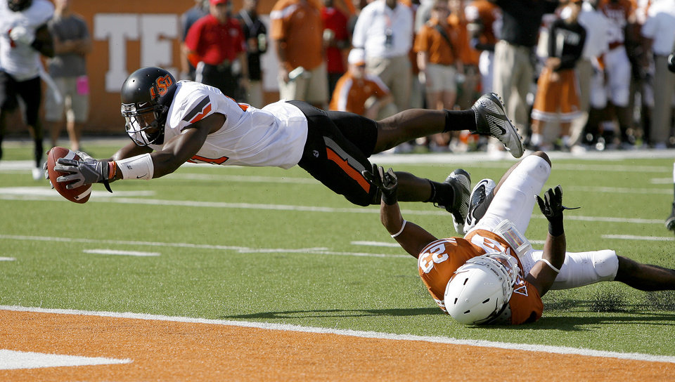 Oklahoma State\'s Justin Blackmon (81) dives for a touchdown as Texas\' Carrington Byndom (23) defends during first half of a college football game between the Oklahoma State University Cowboys (OSU) and the University of Texas Longhorns (UT) at Darrell K Royal-Texas Memorial Stadium in Austin, Texas, Saturday, Oct. 15, 2011. Photo by Sarah Phipps, The Oklahoman