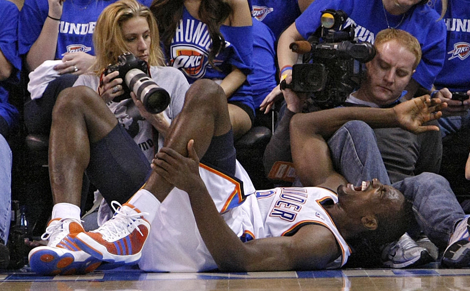Photo - Oklahoma City's Serge Ibaka (9) reacts after an injury during game two of the Western Conference semifinals between the Memphis Grizzlies and the Oklahoma City Thunder in the NBA basketball playoffs at Oklahoma City Arena in Oklahoma City, Tuesday, May 3, 2011. Photo by Chris Landsberger, The Oklahoman