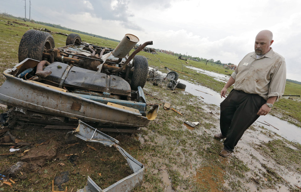 Chris Shelley looks at the damage to his car after a tornado hit the area near 149th and Drexel on Monday, May 20, 2013 in Oklahoma City, Okla.  Photo by Chris Landsberger, The Oklahoman